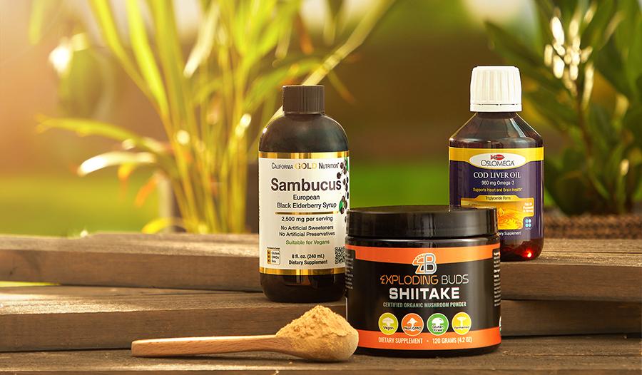 Superfoods on table: elderberry sambucus, cod liver oil, and shiitake mushrooms