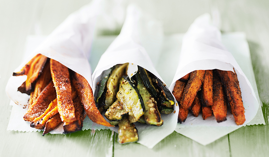 Carrot, zucchini, and sweet potato fries on table