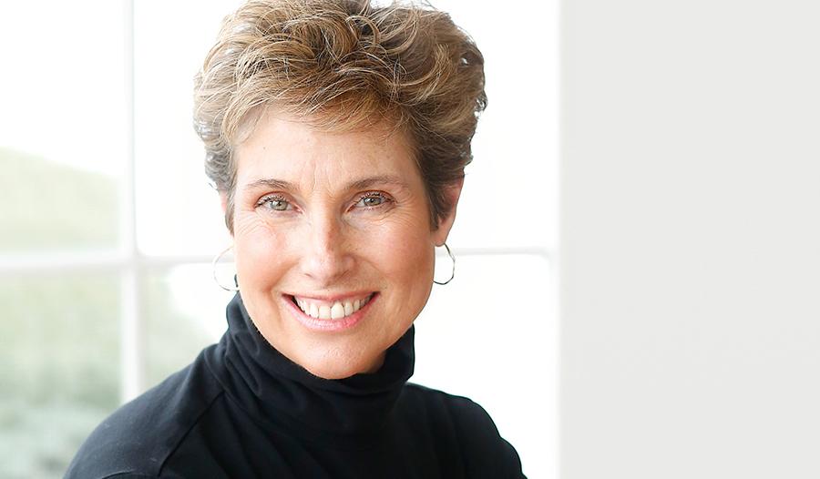 portrait of middle aged woman wearing black turtleneck