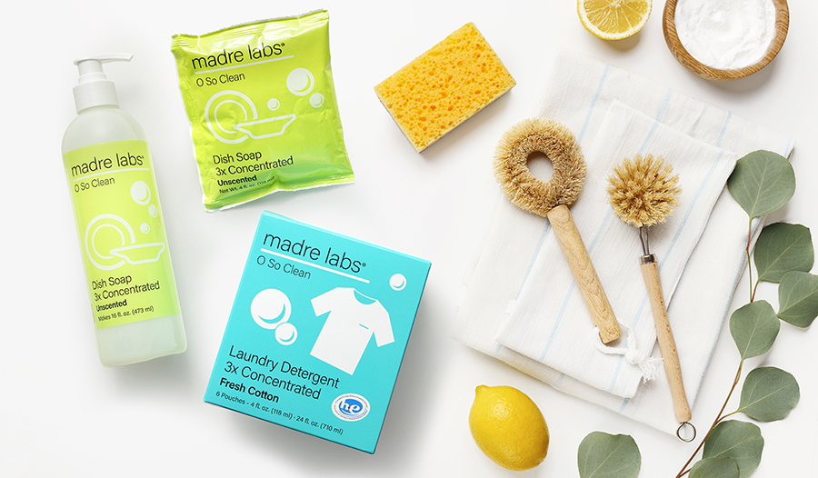 Eco-friendly cleaning and household item flat lay of laundry detergent, soap, sponges