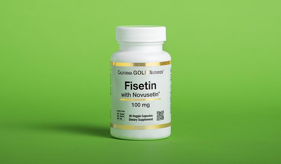Fisetin supplement on green background