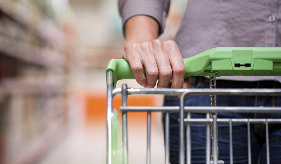 Close up of hand on a shopping cart
