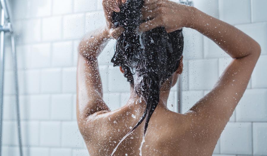 woman in shower washing hair