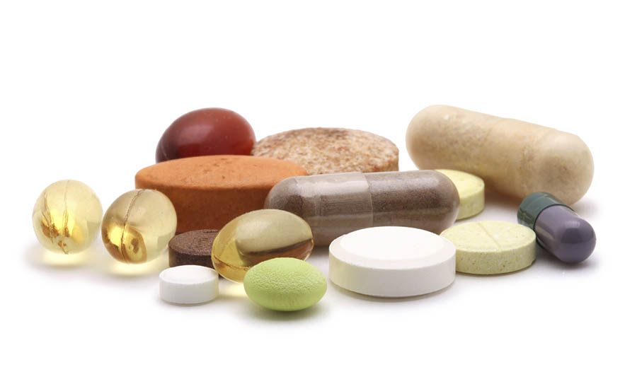 Supplements and vitamins on white background