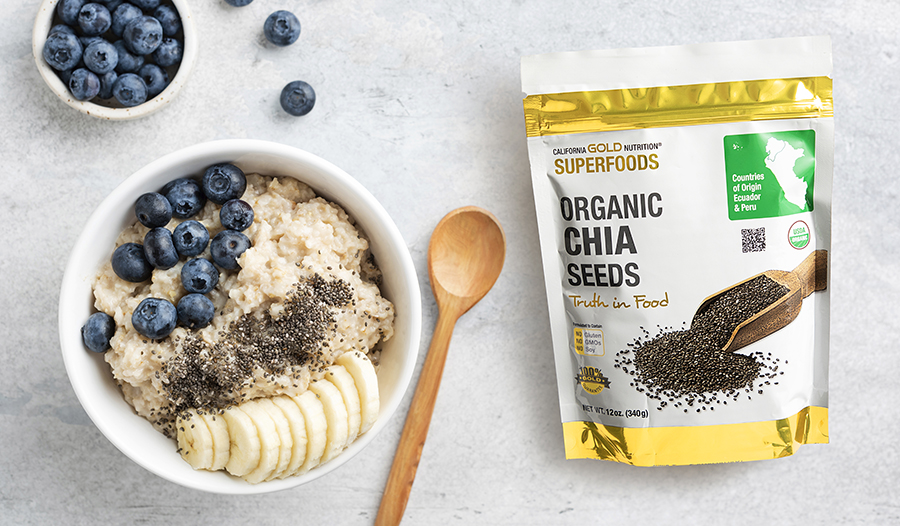 Oatmeal topped with blueberries, chia seeds, and banana on a granite counter