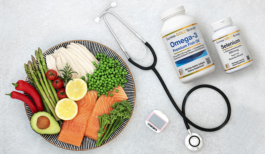 Plate of healthy foods, supplements, glucose monitor, and stethoscope