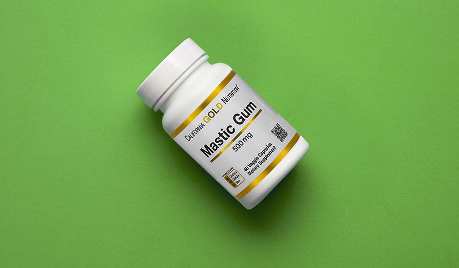 Mastic gum supplement on green background