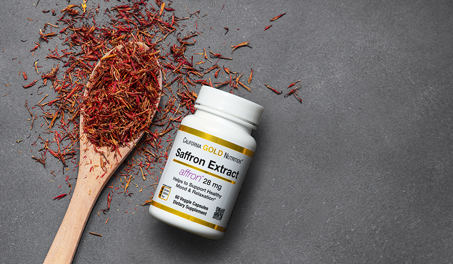 Saffron spice on table and saffron extract supplements