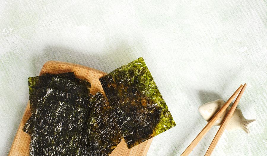 Roasted seaweed snack on wood block with chopsticks