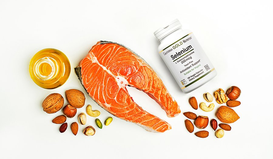 Food sources of selenium: nuts, seafood, and supplement bottle on table