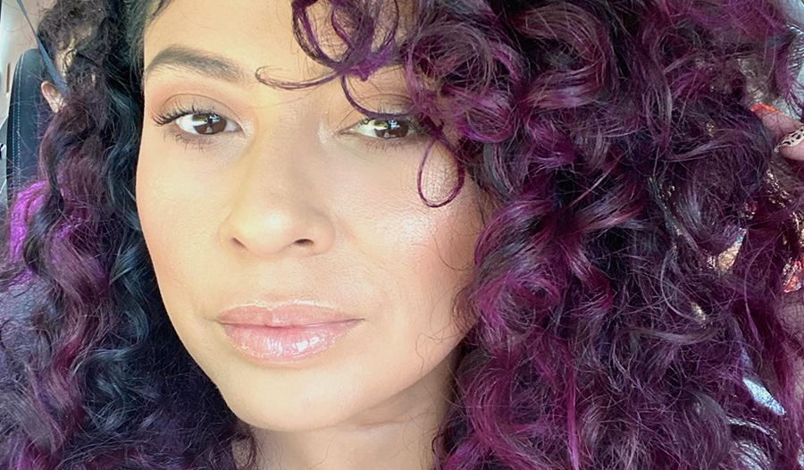 esthetician vanessa lopez showing off her skin that she takes care of as self-care