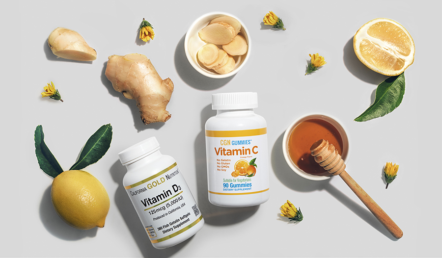 Lemon, ginger, honey, vitamin C, Vitamin D flat lay on white background with flowers
