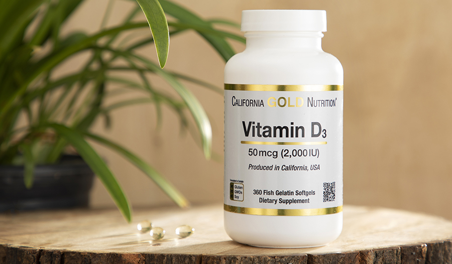 Vitamin D supplement on wooden table